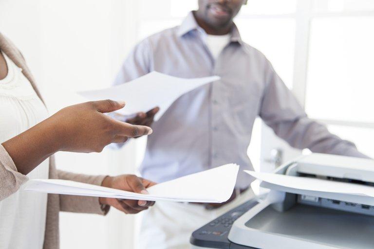 passing printed paper