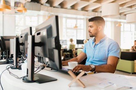 Guy using computer at desk