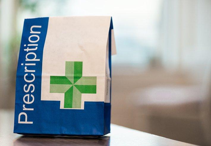 Prescription medicine in a paper bag
